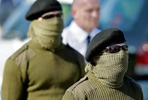 Mourners attend the funeral of Real IRA member Alan Ryan. Photo: PA