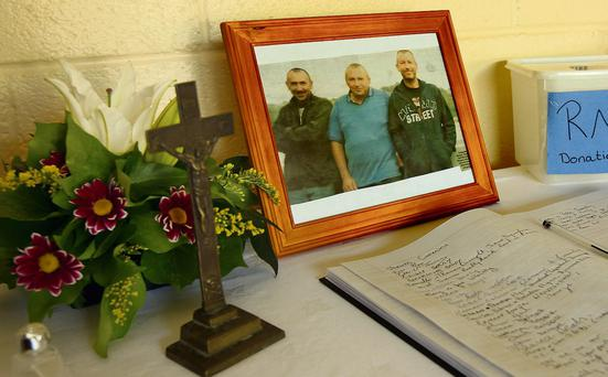 A book of condonence in the community centre in the quiet fishing village of Passage East, Waterford, yesterday, home to the three drowned brothers Kenny, Shane and Paul Bolger. Photo: Tony Gavin