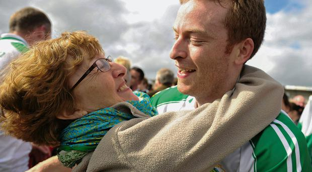 London player Danny Ryan gets a hug from his mother Kathryn
