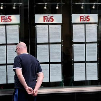A man looks at jobs on offer at an FAS employment centre in Dublin