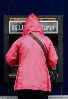 A customer uses an Ulster Bank ATM in Coleraine