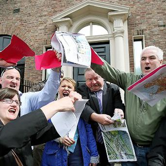 Protesters at the Shelbourne Hotel rip up copies of a property brochure in protest at the previous sale of properties by disgraced Irish banks