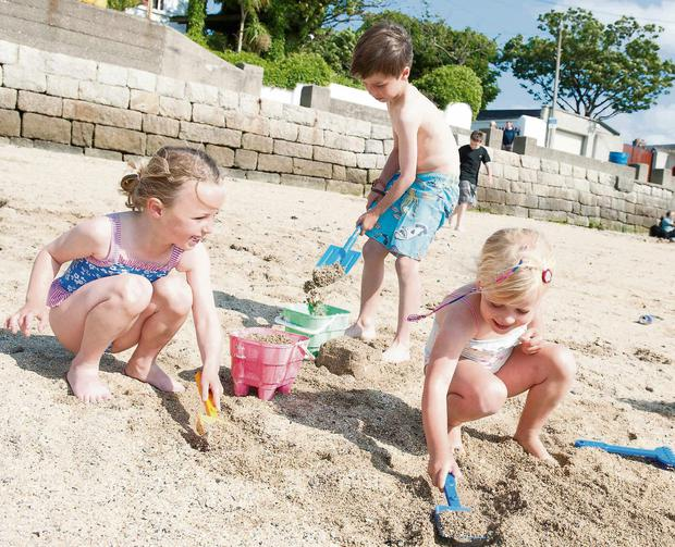 Left to right: Kate (5) and George O'Brien (7) with Molly O'Connell (5) on the beach at Sandycove, Dublin