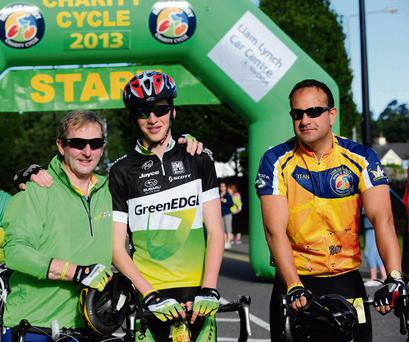 L-R: Taoiseach Enda Kenny with his son Ferdia and Transport Minister Leo Varadkar at the start line