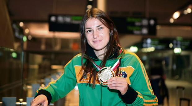 Gold medalist Katie Taylor arriving home at Dublin airport from the European Union Women's Championship