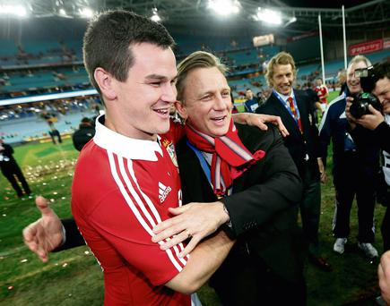 Jonny Sexton in party mood as he puts his arm around actor Daniel Craig following the Lions' victory