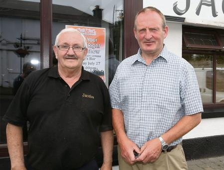 Retired Detective Garda Dessie Brennan, right, with barman Tommy Quinn from Jacob's Bar, Saggart
