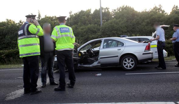 Gardai at the M1-M50 junction, where they intercepted a car that rammed three squad cars and injured a garda