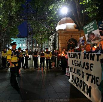 Rival crowds gathered at Leinster House in Dublin as TDs debated the abortion Bill