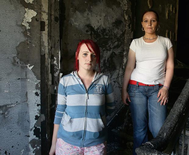 Lisa Gibbons and Natalie Lawrence in the fire-damaged Thornfield Square in Clondalkin