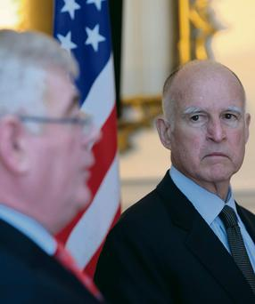 Governor of California Jerry Brown listens as Tanaiste Eamon Gilmore speaks at the Department of Foreign Affairs in Dublin