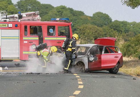 Emergency services attend the scene of the crash outside Loughrea, Co Galway.