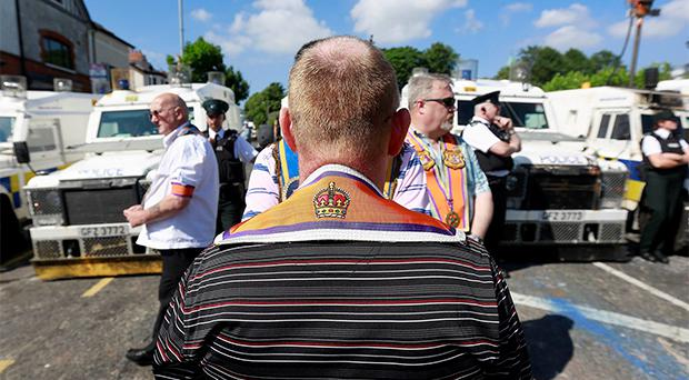 Members of the Orange Order take protest after police blocked an Orange Parade from marching past the Nationalist Ardoyne area