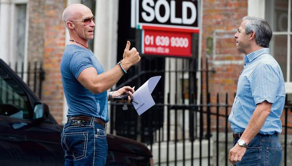FIGHTING FIT: Above, asked if he was working out, former developer Donal Caulfield gave journalist Ronald Quinlan the thumbs up and said, 'You gotta!'. Photo: David Conachy