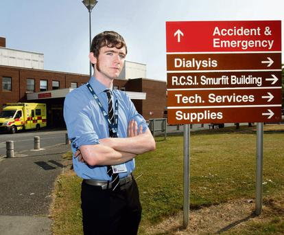 Exhausting: Dr John Duddy, who often works 36 hours straight, outside the Accident and Emergency Department at Beaumont Hospital. Photo: Tony Gavin