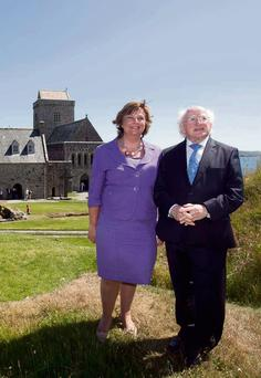 HOME OF LEARNING: President Higgins and wife Sabina on the island of Iona yesterday