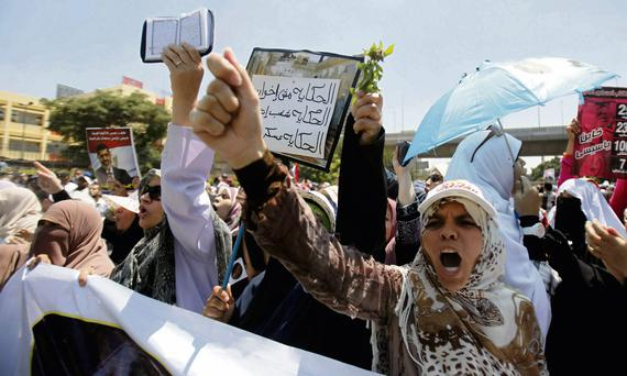 Angry female members of the Muslim Brotherhood and supporters of ousted Mohammed Morsi shout slogans