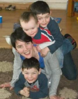 Jack McDonnell with his twin brothers, Sean and Philip, and mother Carmel Cummins, from Doon, Co Limerick