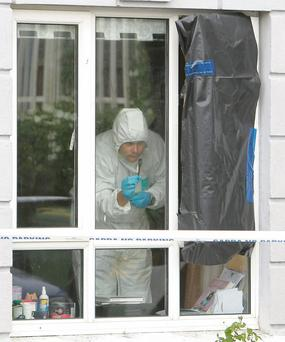 Garda forensic officers examine a home at Sandfield Mews, Ennis, Co Clare, where a fatal stabbing took place