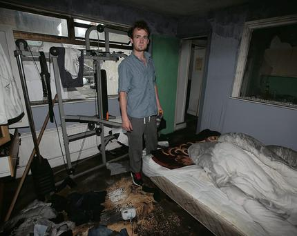 Barry O'Donovan in his room destroyed by smoke damage as a result of a fire at a house in Cabra Park, Dublin
