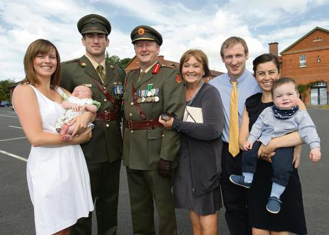 Lt Gen Sean McCann at his retirement ceremony at the Curragh with his wife Fran, son Rory (left) with his wife Pamela and their daughter Alice and son Barry (right) with his wife Sinead and son Ethan.