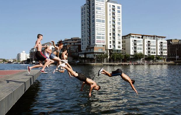 LIKE FISH: Dublin youngsters having fun at the Grand Canal Dock during the heatwave.