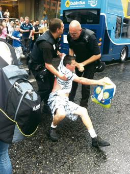 An opportunistic mugger is apprehended by Luas security staff in Dublin