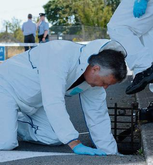 A member of the garda forensic team at the scene of the shooting in Dublin