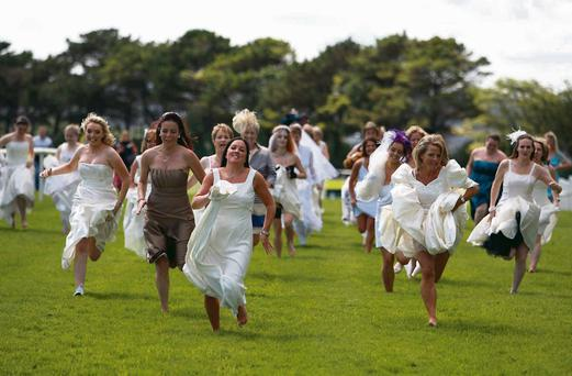 Above: women in bridal wear run in aid of the Special Olympics at the Galway Races