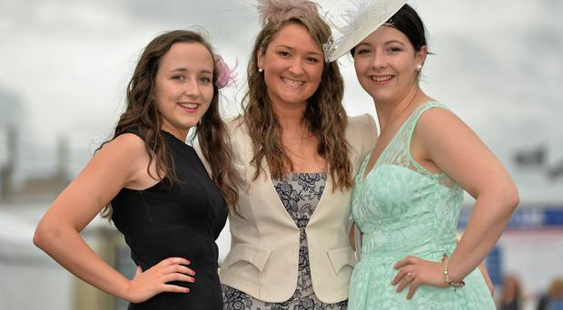 Karina Walton, centre, from Kilkenny City, with Grace and Lisa Kenneally, right, both from Kanturk, Co. Cork, enjoying Ladies Day at the Galway Racing Festival