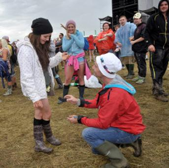 Graham Thomas proposes to his girlfriend Robyn Messitt from Wexford Town before Rizzle Kicks performance at Oxegen Festival 2013.