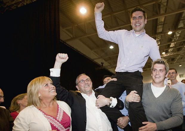 Andrew McGuinness celebrates his election to Kilkenny Borough Council with his mother Margaret, father John (TD) and brother John