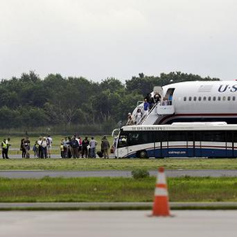 A plane from Ireland makes an emergency landing in Philadelphia because of an unspecified threat (AP)