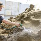 Niall McGee puts the finishing touches to a sand sculpture of an RNLI lifeboat at Duncannon Beach, Co Wexford