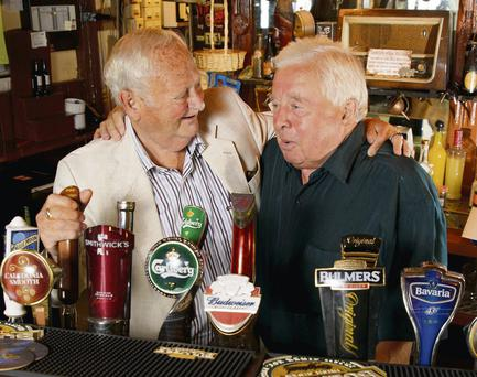 Former proprietor Paul O'Toole Senior (left) wishes the best of luck to Joe Duggan, the new owner of the Harbour Bar in Bray, Co Wicklow