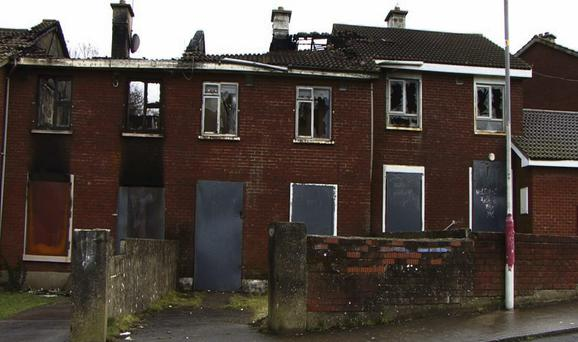 LIVING HELL: Burnt-out and boarded-up houses show the kind of damage inflicted on the Moyross and Southill area of Limerick by criminal gangs