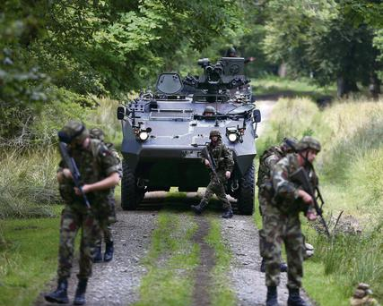 Peacekeeping troops carry out an anti-ambush operation on patrol with an armoured personnel carrier in the Glen of Imaal, Co Wicklow, before their deployment to Syria