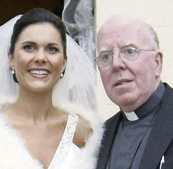 Michaela and Bishop John McAreavey at her wedding.