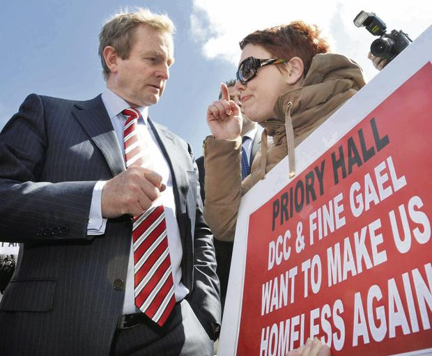 Taoiseach Enda Kenny talking to Stephanie Meehan, who was protesting with other Priory Hall residents, in 2012
