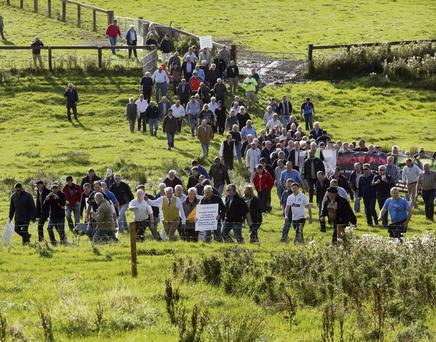 UNITED: Protesters walk across fields to occupy Kennycourt Stud, Co Kildare, yesterday.