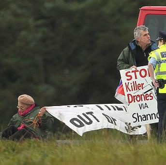 Shannon Peace activists Niall Farrell and Margaretta D'arcy are detained at Shannon Airport