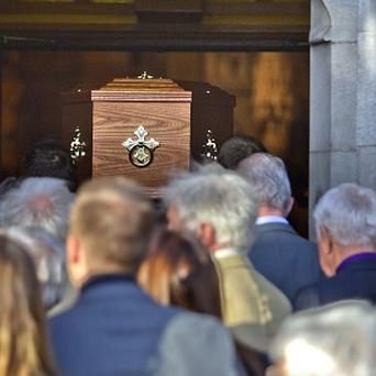 The coffin of poet Seamus Heaney is carried into the Church of the Scared Heart in Donnybrook, Dublin.