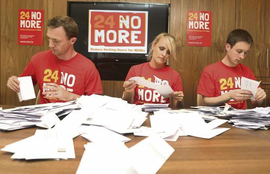 IMO staff Val Moran, Leah Kenny and Tom Smyth from the industrial-relations unit sort out ballot papers after junior doctors voted to take industrial action over working hours