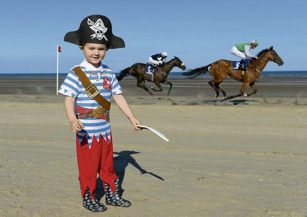 Reuben Stafford (4), from Laytown, gets into the spirit of things at Laytown Strand Races