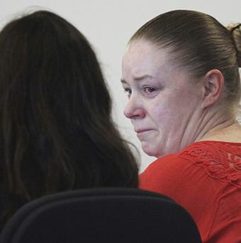 Aisling Brady McCarthy sits with her lawyer during a hearing (AP/The Boston Globe,Wendy Maeda)