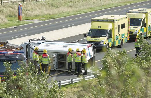 Emergency crews at the scene of the accident where a prison van flipped over near Loughrea in Co Galway