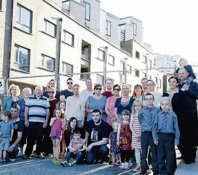 Former Priory Hall residents outside the abandoned apartment complex