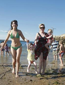Inma Lao Espejo and Roisin Vaughan pictured with twins Emily and Eyse in Sandycove, Dublin