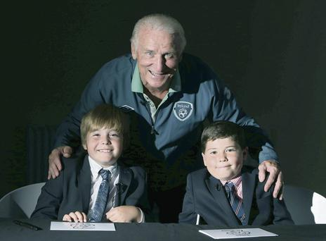 Ireland manager Giovanni Trapattoni with Matthew Nolan (9) and Matthew Hanley (8) after the filming of Three's soccer mini-quiz ad
