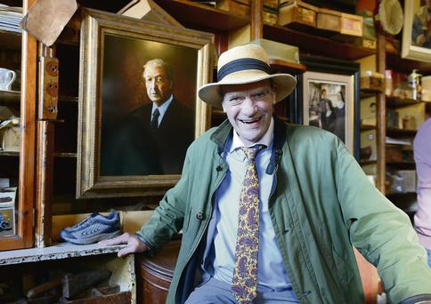 Oliver MacDonnell sits in front of the portrait of the late Charlie Haughey in his bar, Dick Mack's, in Dingle
